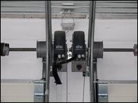 DITEC tengelyvégi kapunyitó motorok szekcionált kapukhoz